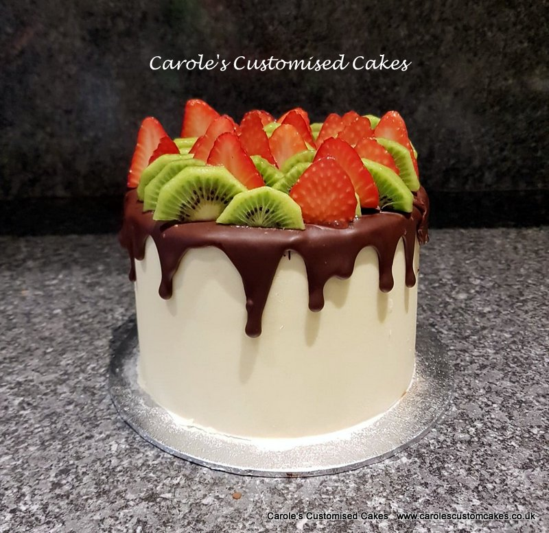 kiwi and strawberry topped cake