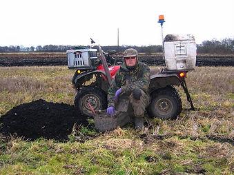 John Noblett mole catcher from Lancashire Mole Control next to a large mole nest