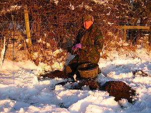 John Noblett Master Mole Catcher setting mole traps in the winter snow