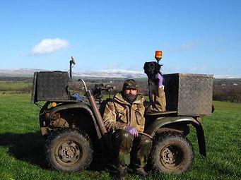 John Noblett mole catcher from Lancashire Mole Control with his mole dog Kike