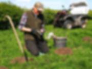 John Noblett Master Mole Catcher setting mole traps in the summer sunshine