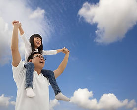 daughter-on-shoulder-blue-sky.jpg