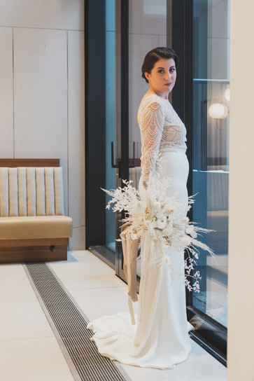 Bride with bouquet of dried flowers