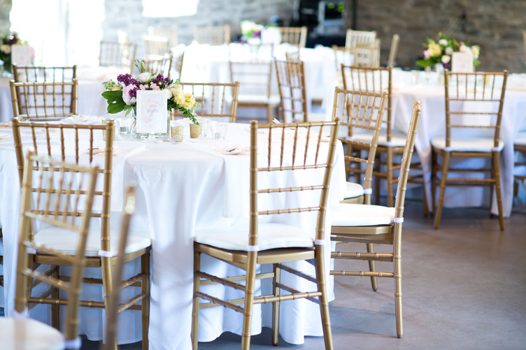 Wedding reception with round tables and chiviari chairs