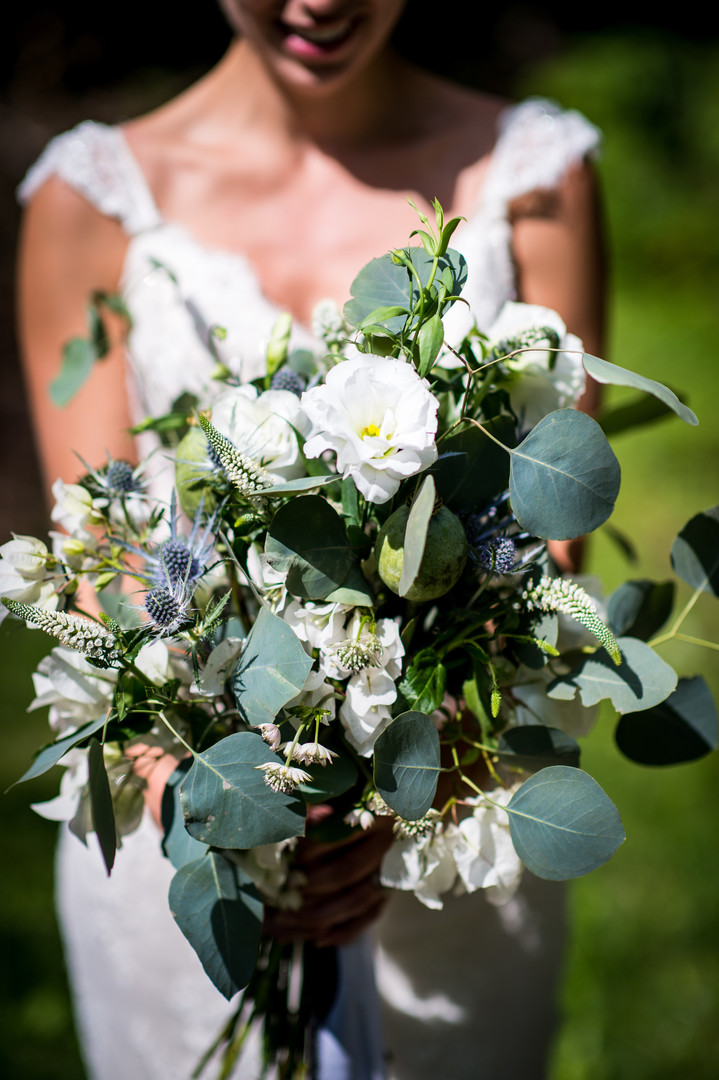Bride with white and grey bouquet