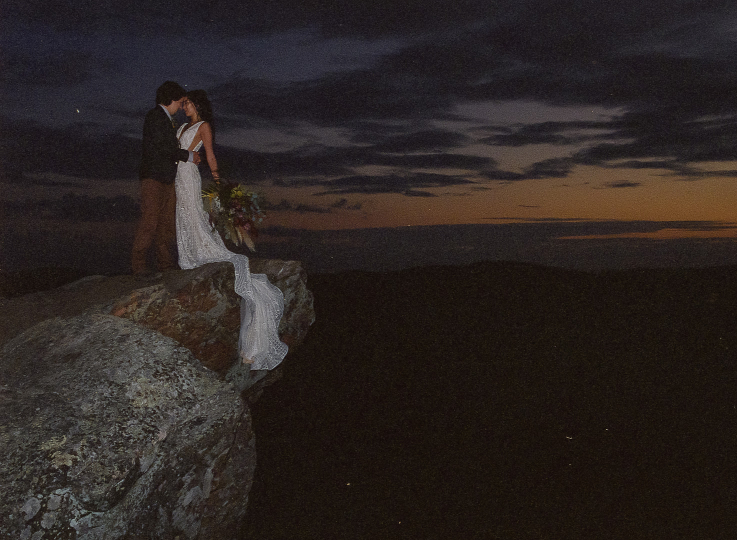 Bride and Groom eloping on the edge of a cliff