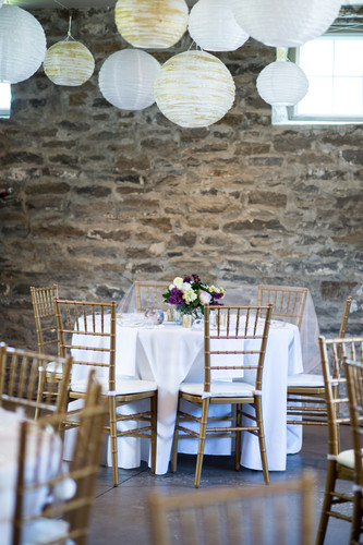 Wedding reception with chiavari chairs and ceiling lanterns