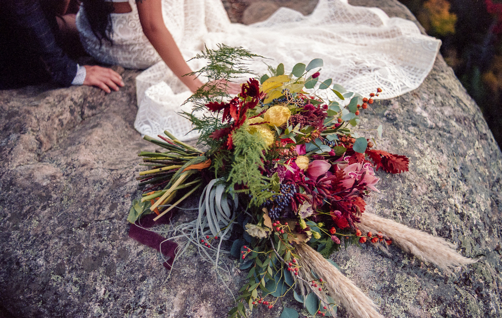Bridal bouquet on a rock with orchids
