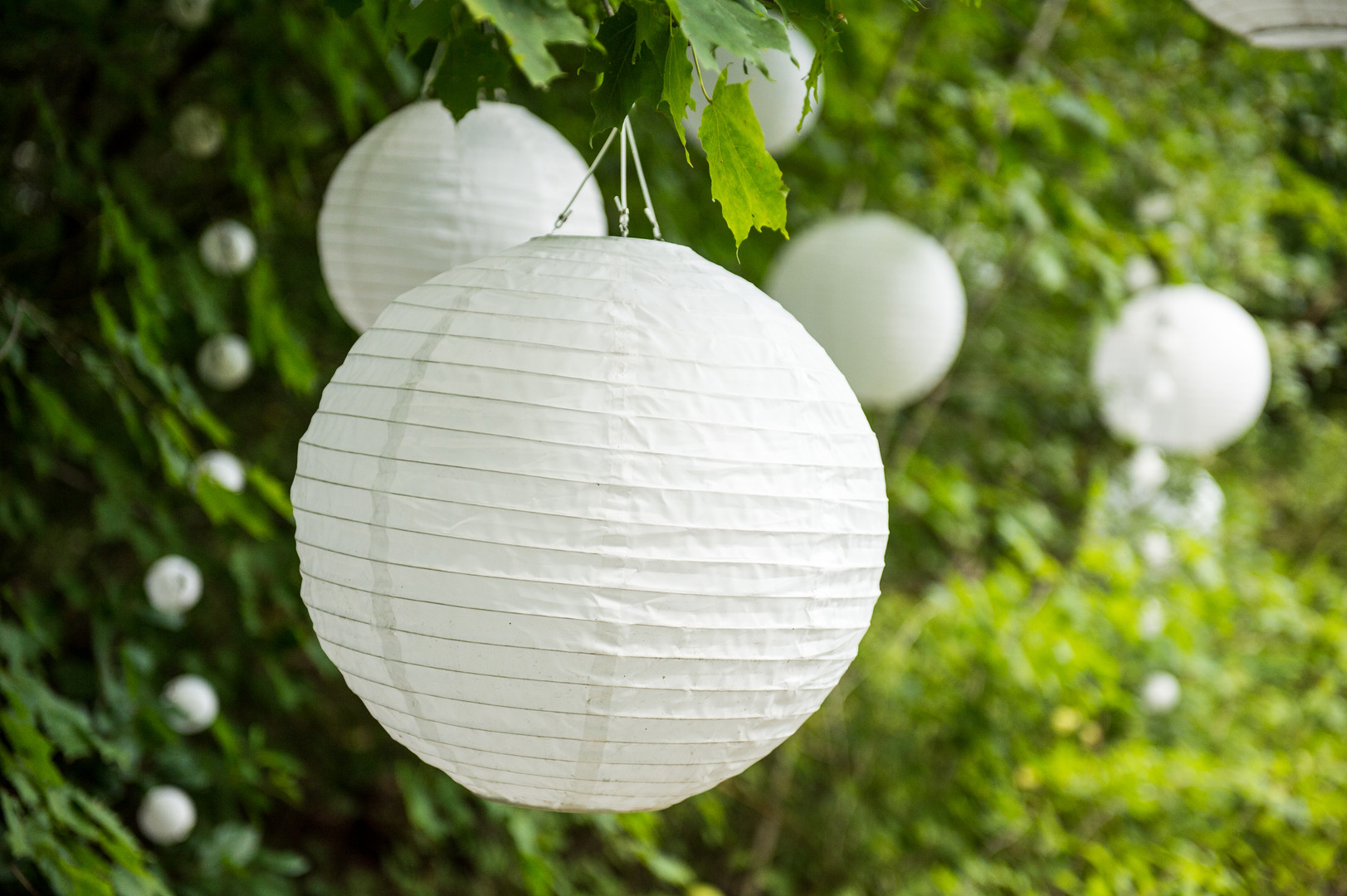 Outdoor summer wedding reception white lanterns
