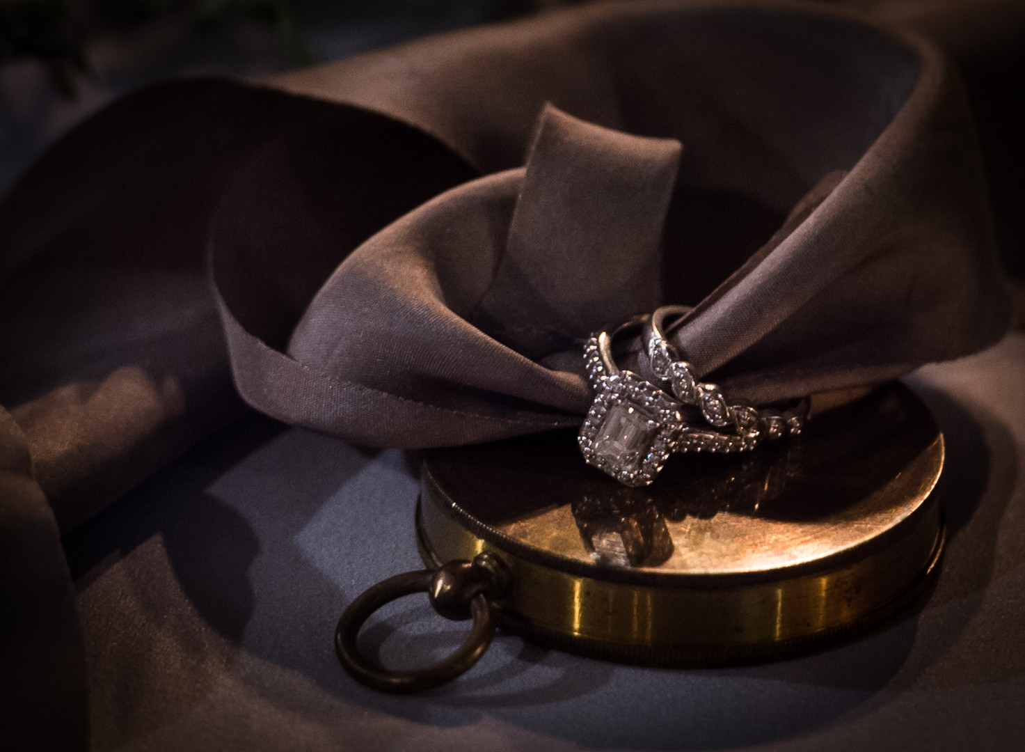 Bride's rings with ribbon and gold pocket watch