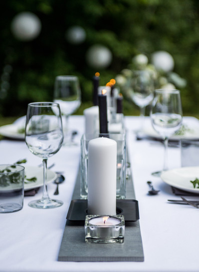 Outdoor wedding reception table setting with candles