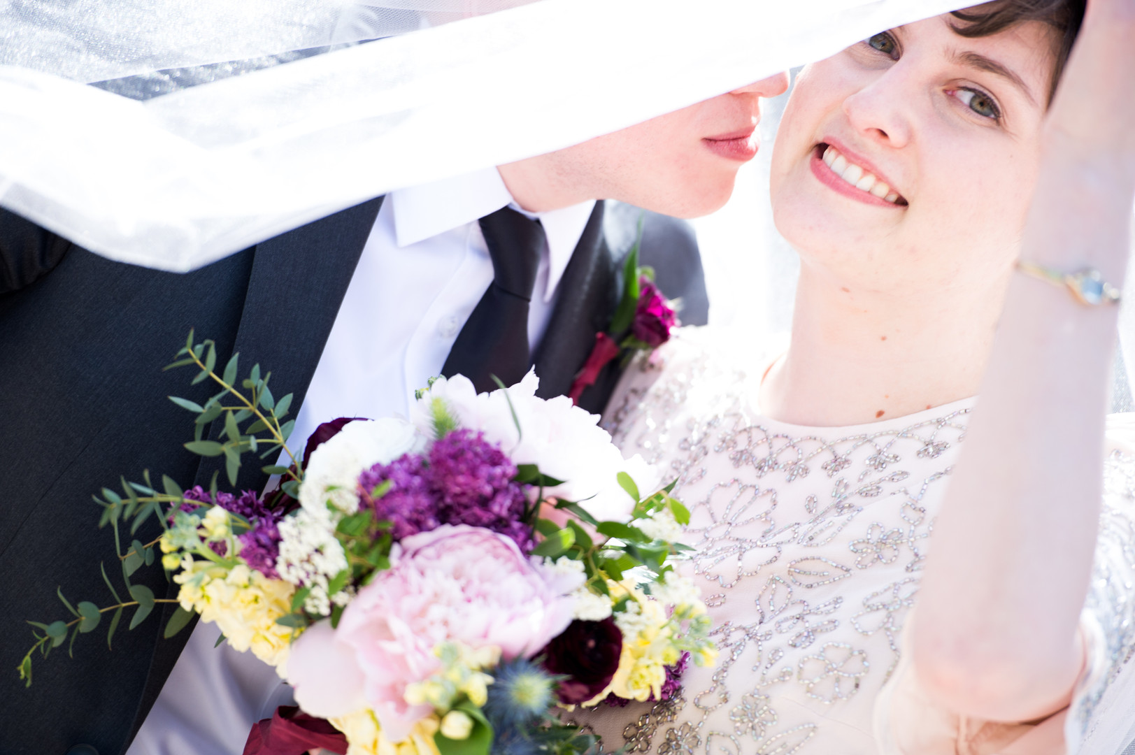 Bride and Groom with bouquet and veil