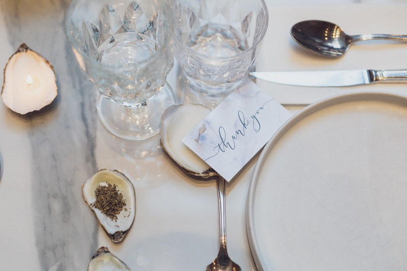 Wedding place setting with oyster shell candles