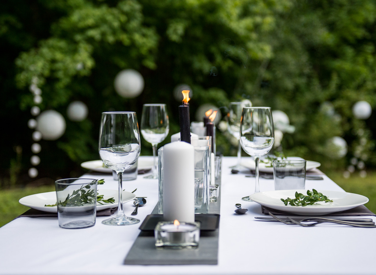 Outdoor summer wedding reception with candles and garden lanterns
