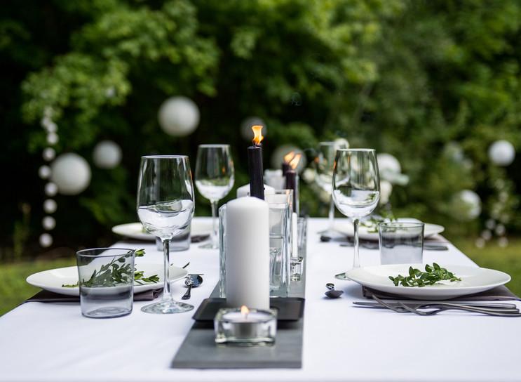 Outdoor summer wedding reception with candles and garden lanterns