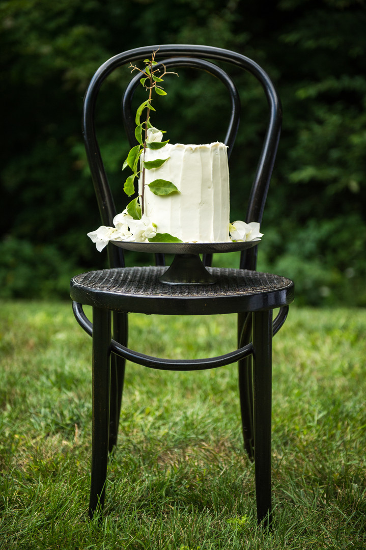 White wedding cake with greenery and white flowers