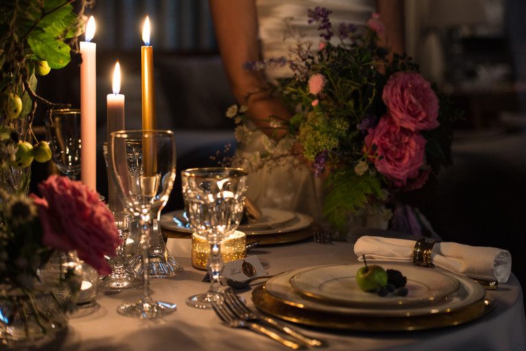 Wedding table setting with candles and fruit