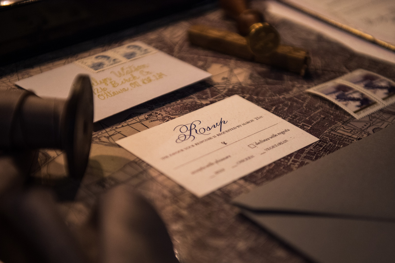 Wedding Invitation with ribbon, wax seal and postage stamps