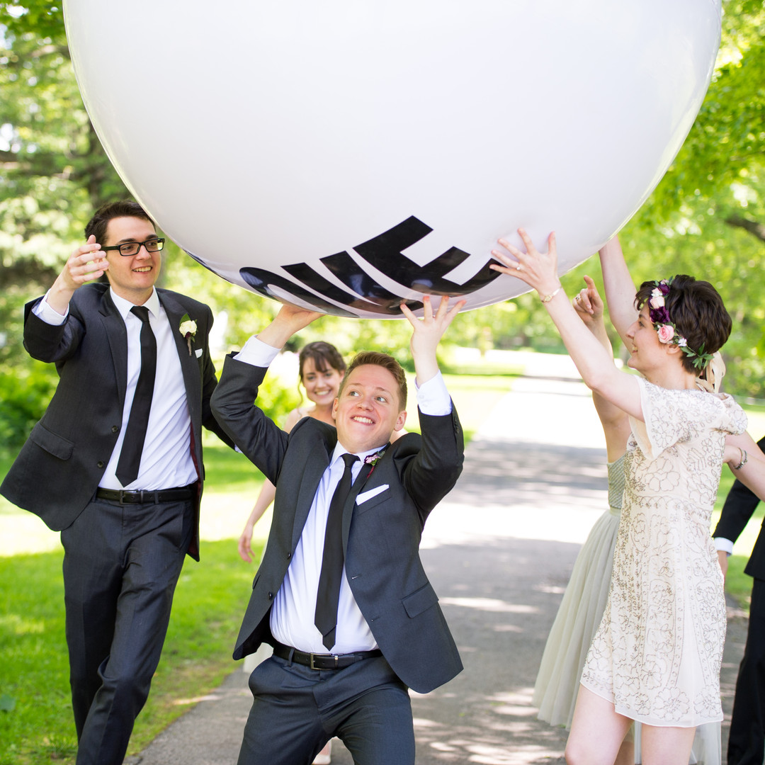Wedding party with five-foot Big Love Ball