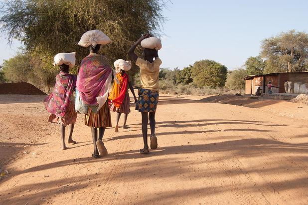African Pokot girls leave the market in