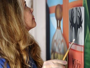 Sally Kindberg in the studio working on the KISS painting 2020