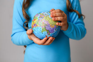 kid-holding-earth-globe_98296-561.jpg