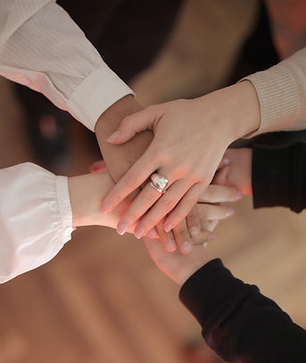 crop-friends-stacking-hands-together-383