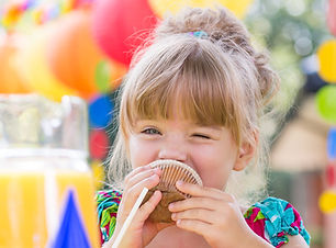 girl-eating-muffin-during-party-PPVSAL7_