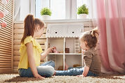 girls-play-with-doll-house-PFAEHGK.jpg