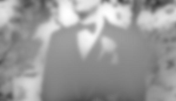 A man in tuxedo, in a sepia fog.