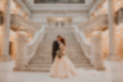 Bridal picture of couple kissing at bottom of stairs