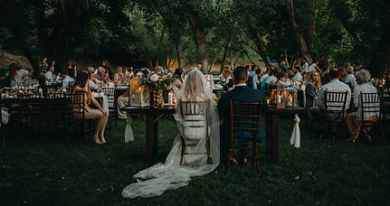 Natural light candle wedding; bride and groom eating dinner at a reception