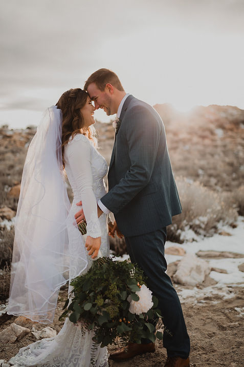 Antelope island bridal picture couple lauging with sun rays