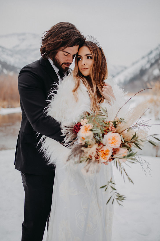 Chelsea Jessop photography Natural light bridal photo on a mountain with snow and flowers