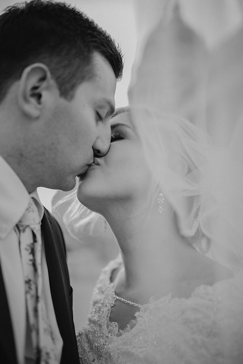 Chelsea Jessop photography Natural light bridal photo; black and white; kissing under veil