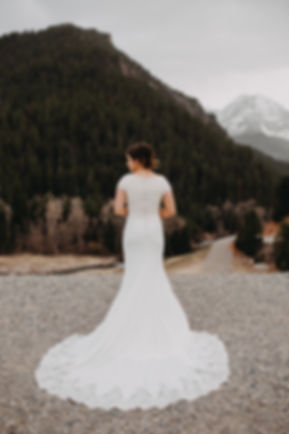 Chelsea Jessop photography Natural light bridal photo on a mountain detailed dress shot