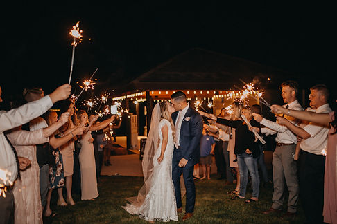 Chelsea Jessop photography; weddng day sparkler exit couple kissing