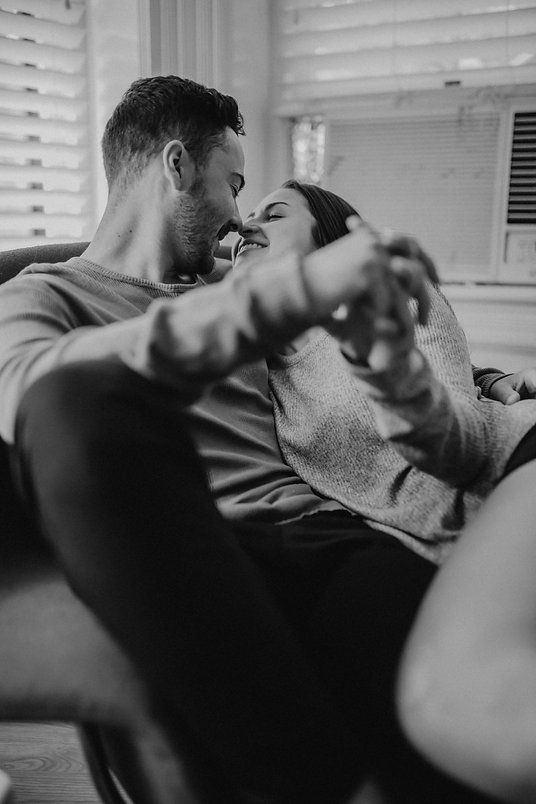 Chelsea Jessop photography couple laughing and snuggling in home