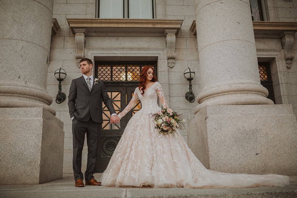 Bridal picture outside with couple looking away