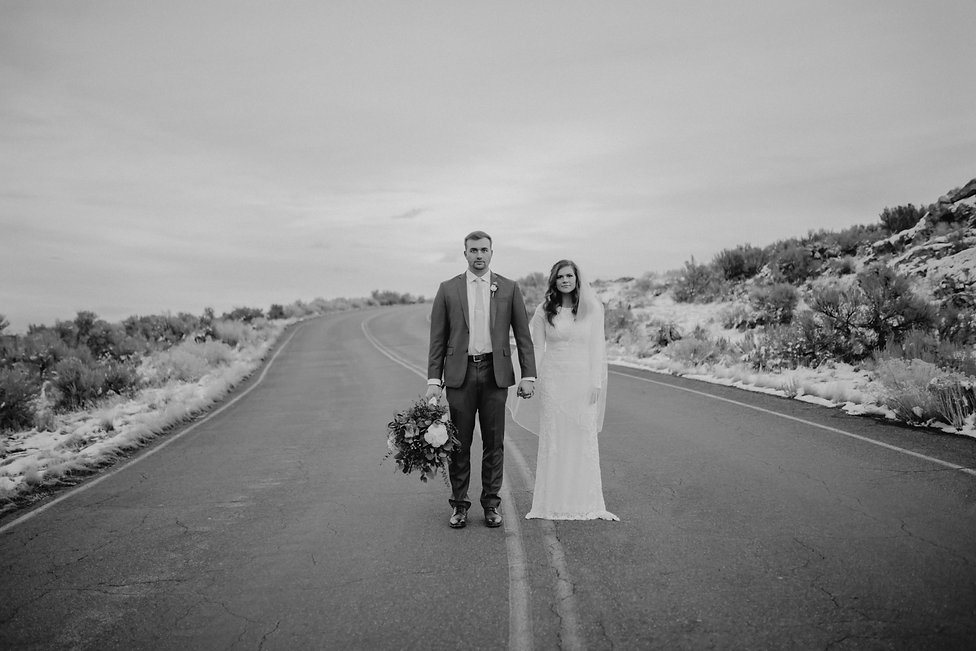Chelsea Jessop Photography; Couple standing in the middle of the road on Antelope Island
