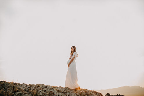 Chelsea Jessop photography pregnant woman standing on rock during sunset