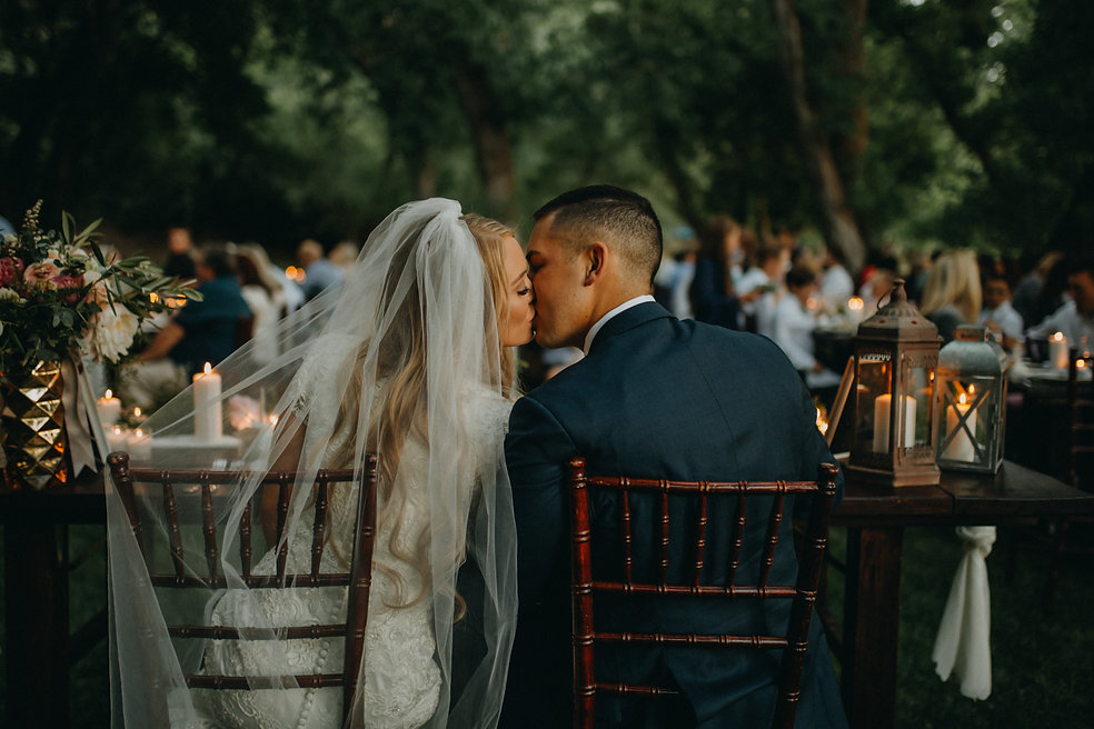 Chelsea Jessop photography couple kissing at table on wedding day