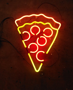 A slice of heaven or pizza neon sign