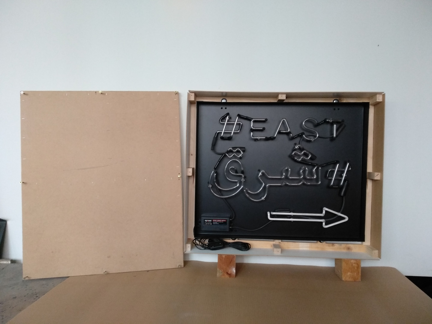 east neon sign in wooden box ready for shipment