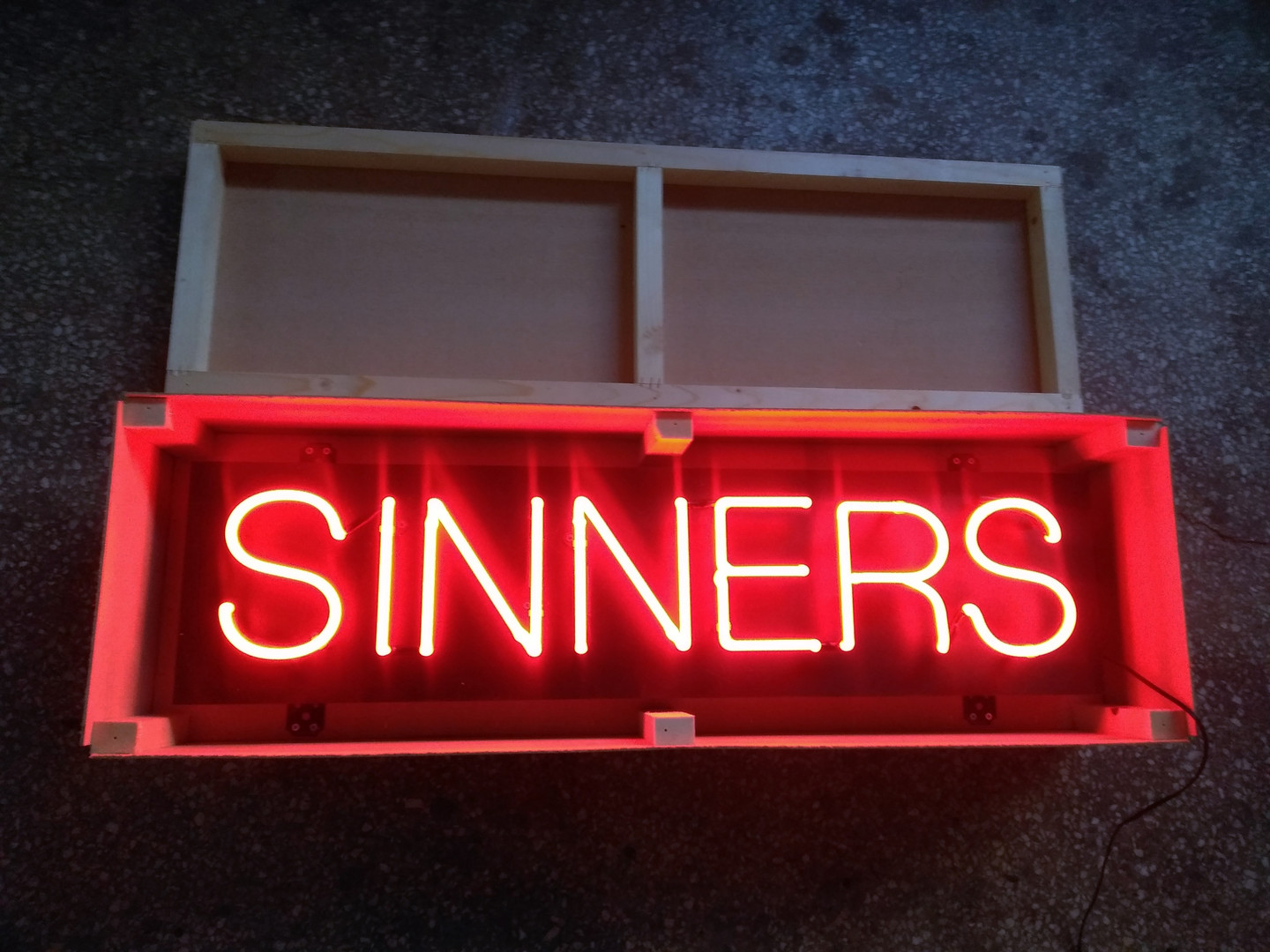 Sinners neon lighting sign in wooden box