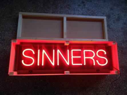 Sinners neon lighting sign in wooden box