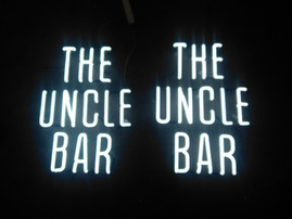 the uncle bar neon sign