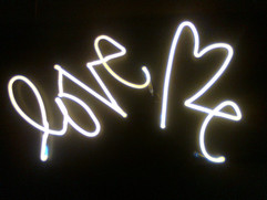 love me white neon sign