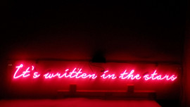 It's written in the stars neon sign