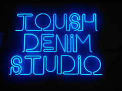 tourism denim studio neon sign